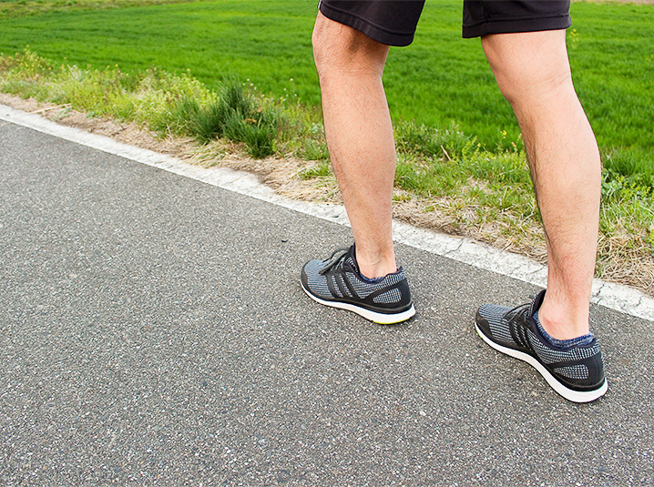 man running outside for weight loss workout